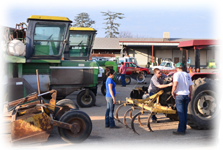 Ag Operations working on tractor
